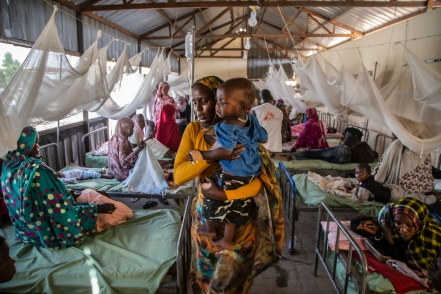 A mother holds her child in a ward for malaria patients at the Paediatrics hospital, in El Fasher, North Darfur, Sudan.